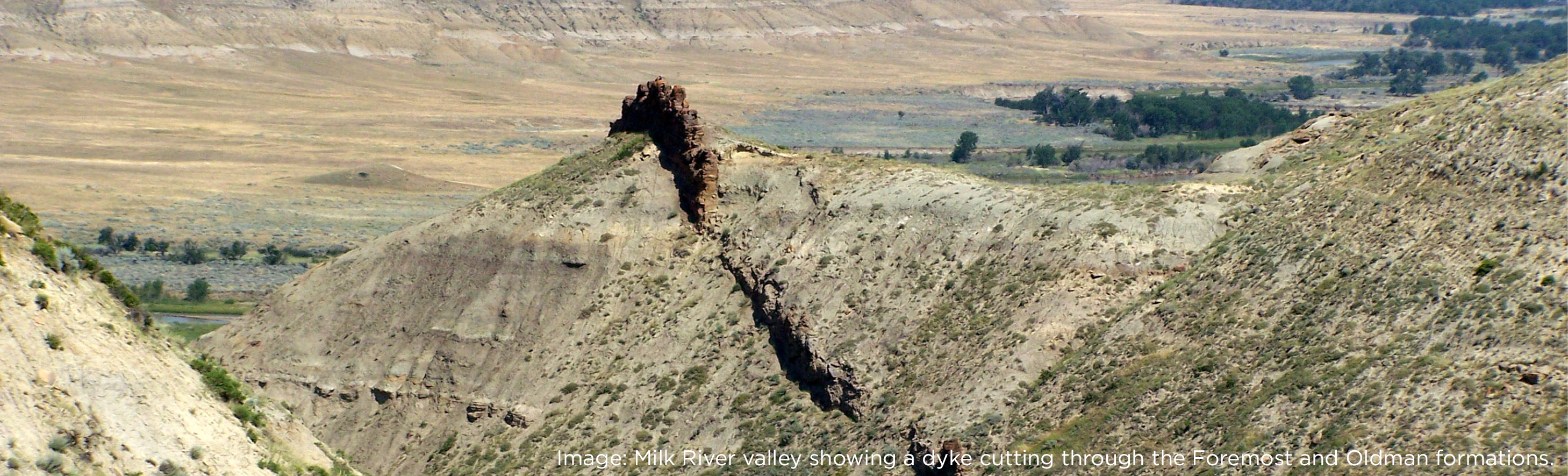 Milk River valley showing a dike cutting through the Oldman and Foremost formations.